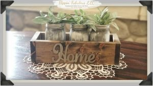 home box with mason jars and greenery