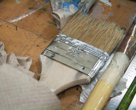 paintbrushes on wood